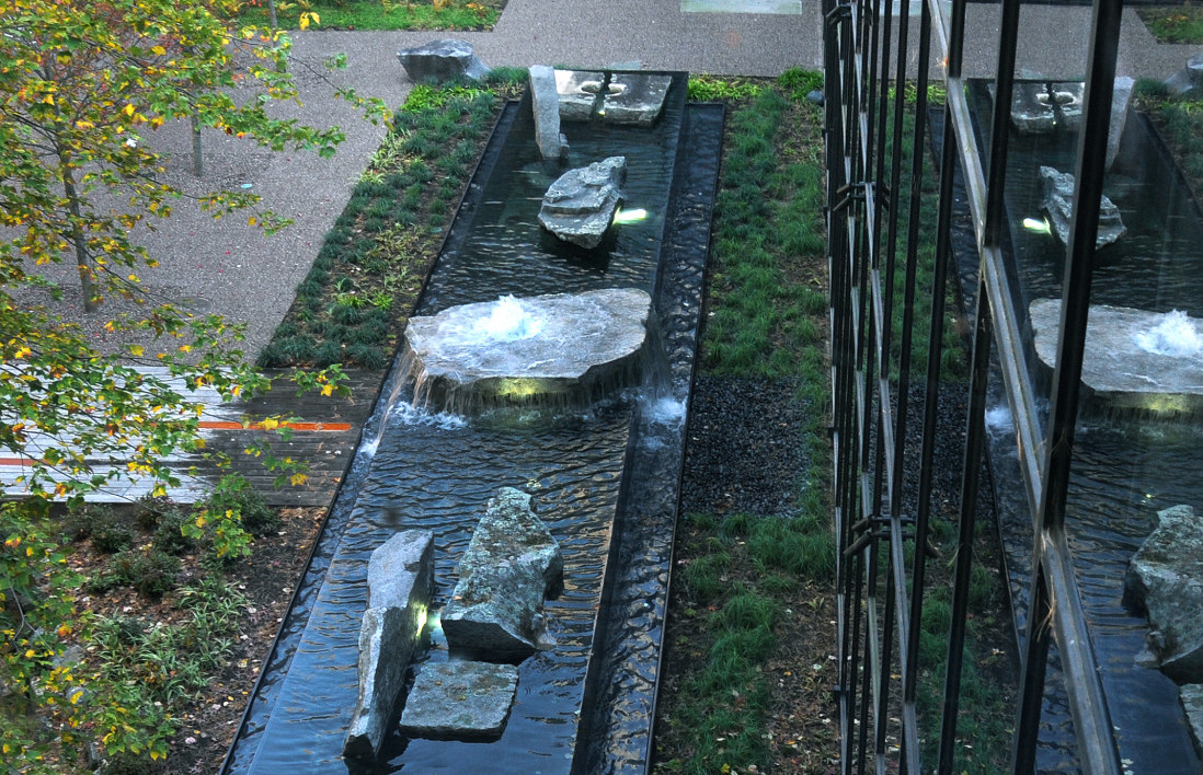 Negative edge water feature with art stones