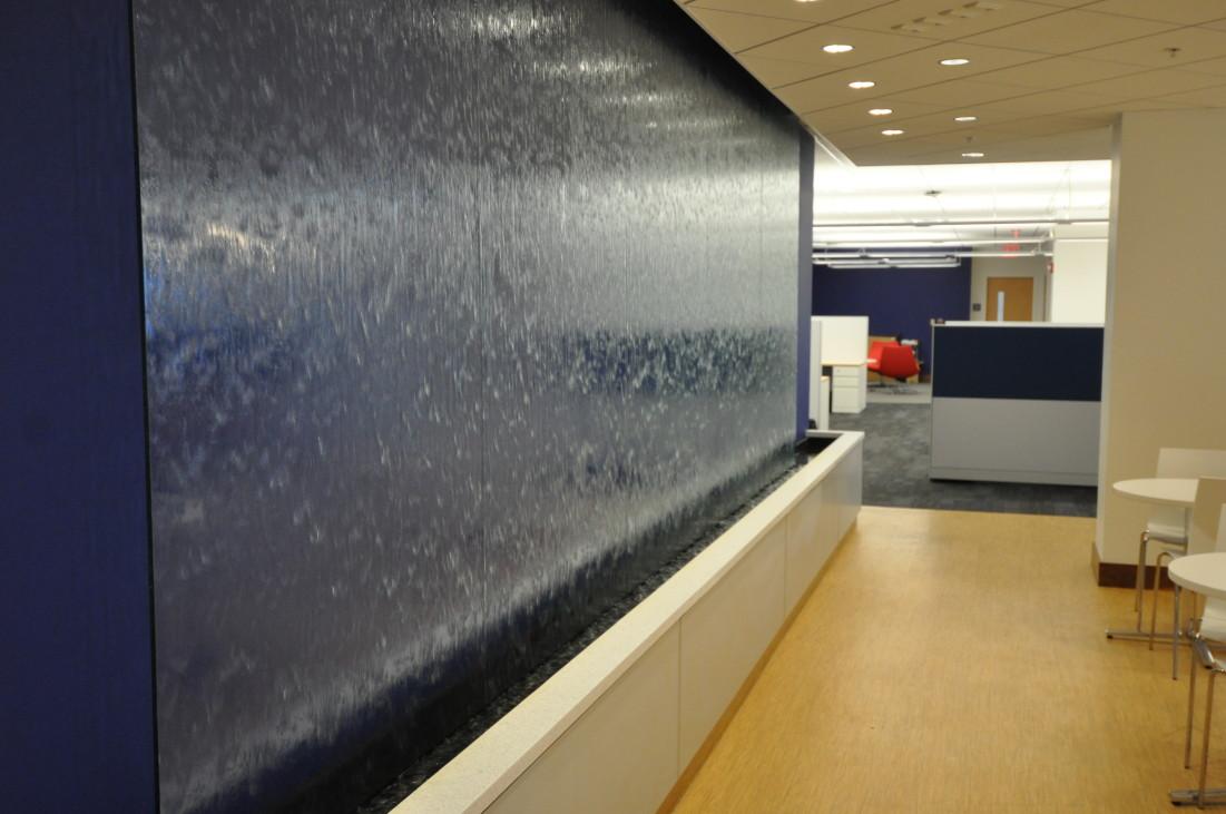 Glass water wall in employee lounge, NetBrain Technologies, Burlington, MA.