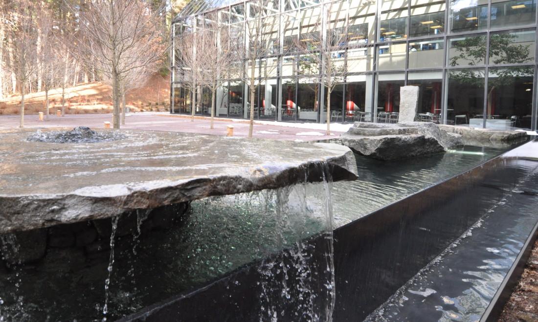 negative edge raised pool with stones gallery water structures negative edge raised pool with stones