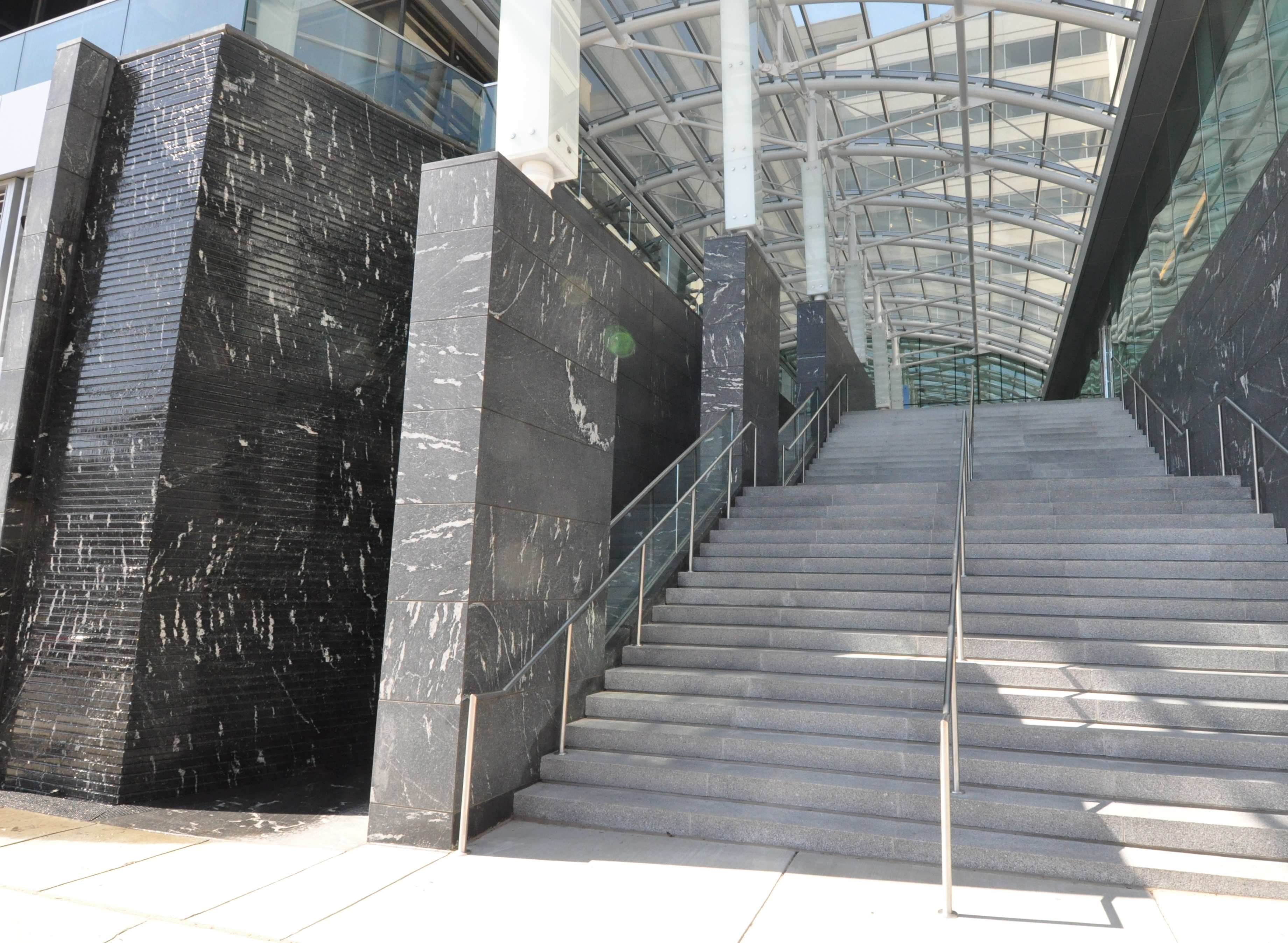 23ft Tall Cut Granite Water Wall, Greensboro Station, McLean, VA. Design by Smith Group JJR.